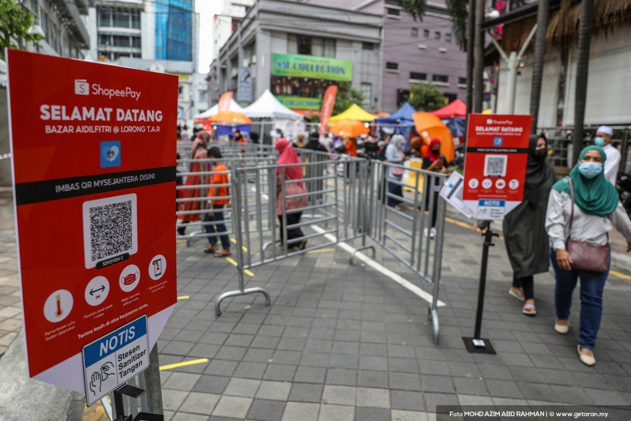 Kawasan masuk dipagar bagi mengawal pergerakan orang ramai. - Gambar oleh Azim Rahman